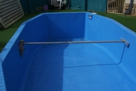 These photos are showing the completed renovation. The fillcoat has been  applied the day before, and these show the pool with the final application, the  topcoat. The colour chosen by the clients is 'Sapphire Blue'.